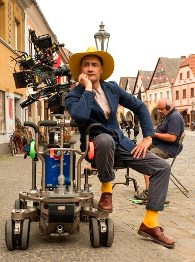 """(Kimberley French/Fox Searchlight Pictures via AP). This image released by Fox Searchlight Pictures shows Writer/Director Taika Waititi on the set of """"Jojo Rabbit."""" On Monday, Jan. 13, Waititi was nominated for an Oscar for adapted screenplay for his w..."""