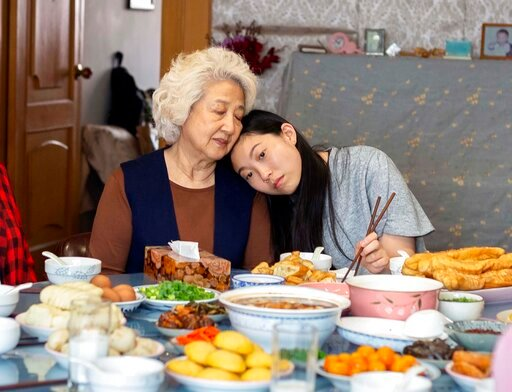 """(Casi Moss/A24 via AP). This image released by A24 films shows Zhao Shuzhen, left, and Awkwafina in a scene from """"The Farewell."""" Awkwafina won a Globe earlier this month for """"The Farewell,"""" it was a proud moment for Asian Americans in Hollywood _ the f..."""