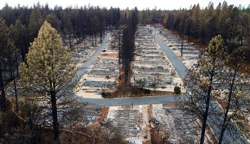 (AP Photo/Noah Berger). File - In this Dec. 3, 2018, file photo, are homes leveled by the Camp Fire line the Ridgewood Mobile Home Park retirement community in Paradise, Calif. A $13.5 billion settlement covering most of the losses from a series of cat...