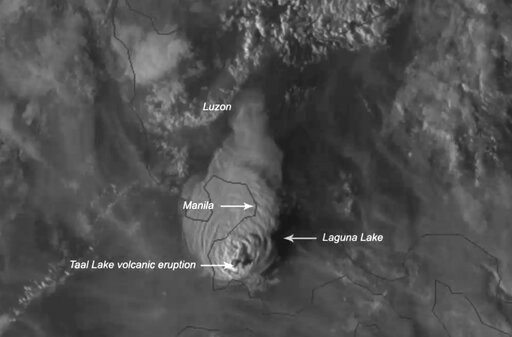 (NOAA via AP). This Jan. 12, 2020, image made available by Himawari-8 satellite via the National Oceanic and Atmospheric Administration (NOAA), shows the eruption of Taal volcano, south of Manila, Philippines. The small volcano near the Philippine capi...