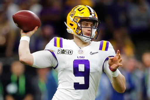 (AP Photo/Gerald Herbert). LSU quarterback Joe Burrow passes against Clemson during the second half of a NCAA College Football Playoff national championship game Monday, Jan. 13, 2020, in New Orleans.