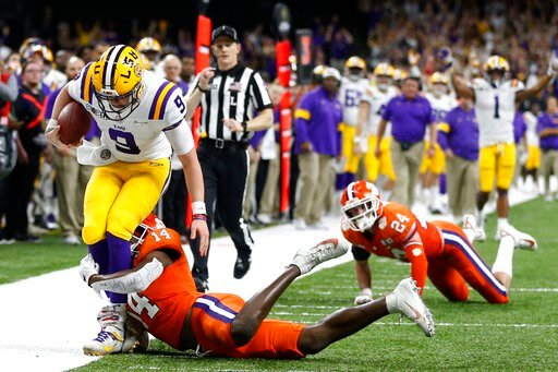 (AP Photo/Gerald Herbert). LSU quarterback Joe Burrow is tackled by LSU defensive back Maurice Hampton Jr. during the first half of a NCAA College Football Playoff national championship game Monday, Jan. 13, 2020, in New Orleans.