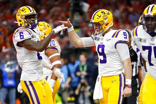 (AP Photo/Gerald Herbert). LSU quarterback Joe Burrow, right, celebrates with wide receiver Terrace Marshall Jr. after scoring against Clemson during the first half of a NCAA College Football Playoff national championship game Monday, Jan. 13, 2020, in...