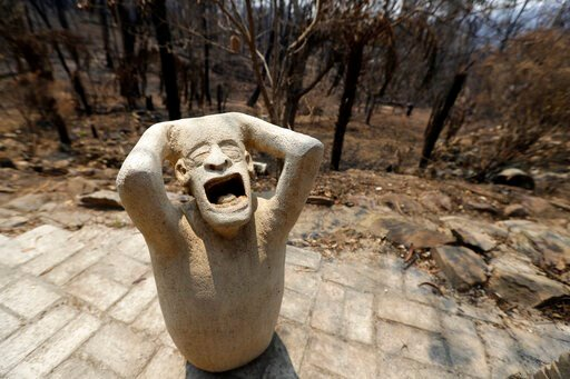 (AP Photo/Rick Rycroft). Sandstone sculptures by local fire captain Ron Threlfall show scenes of distress, Monday, Jan. 13, 2020, in Nerrigundah, Australia, that many residents of the town may have felt as a wildfire ripped through the town on New Year...