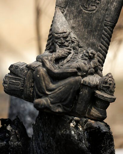 (AP Photo/Rick Rycroft). A blackened wizard ornament sits in a scorched fencepost at Nerrigundah, Australia, Monday, Jan. 13, 2020, after a wildfire ripped through the town on New Year's Eve. The tiny village of Nerrigundah in New South Wales has been ...