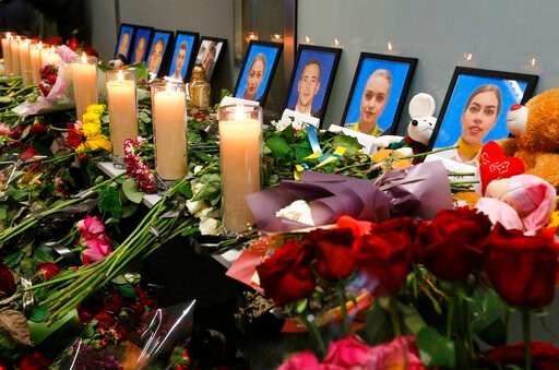 (AP Photo/Efrem Lukatsky). Flowers and candles are placed in front of portraits of the flight crew members of the Ukrainian 737-800 plane that crashed on the outskirts of Tehran, at a memorial inside Borispil international airport outside Kyiv, Ukraine...