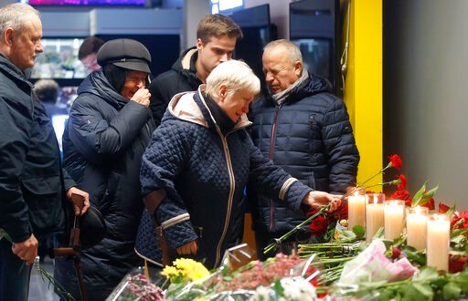 (AP Photo/Efrem Lukatsky). Relatives of one of the flight crew members of the Ukrainian 737-800 plane that crashed on the outskirts of Tehran, stand at a memorial inside Borispil international airport outside Kyiv, Ukraine, Saturday, Jan. 11, 2020. Ukr...