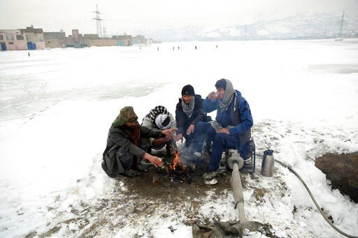 (AP Photo/Rahmat Gul). People sit around a fire to warm themselves after a heavy snowfall in Kabul, Afghanistan, Tuesday, Jan. 14, 2020. Severe winter weather has struck parts of Afghanistan and Pakistan, with heavy snowfall, rains and flash floods tha...