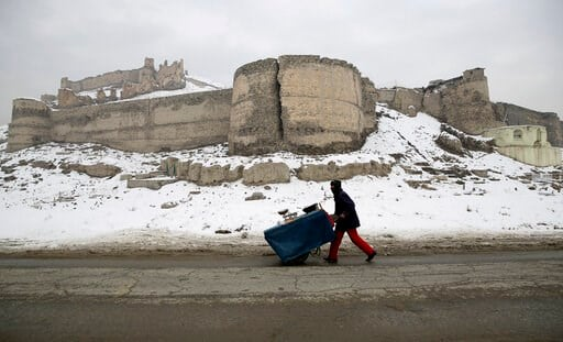 (AP Photo/Rahmat Gul). An Afghan street vendor pulls his hand cart after a heavy snowfall in Kabul, Afghanistan, Tuesday, Jan. 14, 2020. Severe winter weather has struck parts of Afghanistan and Pakistan, with heavy snowfall, rains and flash floods tha...