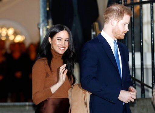 (AP Photo/Frank Augstein, File). FILE - In this Jan. 7, 2020, file photo, Britain's Prince Harry and Meghan, Duchess of Sussex leave after visiting Canada House in London, after their recent stay in Canada. As Prince Harry and Meghan step back as senio...
