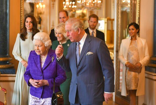 (Dominic Lipinski/Pool via AP, File). FILE - In this March 5, 2019 file photo, Britain's Queen Elizabeth II is joined by Prince Charles, the Prince of Wales, and at rear, from left, Kate, Duchess of Cambridge, Camilla, Duchess of Cornwall, Prince Willi...