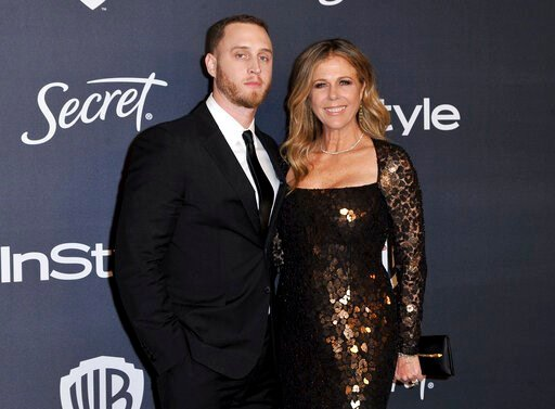 (Richard Shotwell/Invision/AP). Chet Hanks, left, and Rita Wilson arrive at the InStyle and Warner Bros. Golden Globes afterparty at the Beverly Hilton Hotel on Sunday, Jan. 5, 2020, in Beverly Hills, Calif.