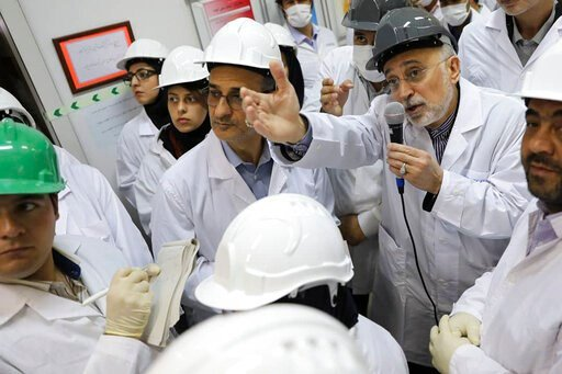 (Atomic Energy Organization of Iran via AP, File). FILE - In this file photo released Nov. 4, 2019 by the Atomic Energy Organization of Iran, Ali Akbar Salehi, head of the organization, speaks with media while visiting Natanz enrichment facility, in ce...