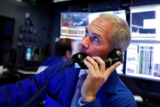 (AP Photo/Richard Drew, File). FILE - In this Jan. 9, 2020, file photo trader Timothy Nick works in his booth on the floor of the New York Stock Exchange. The U.S. stock market opens at 9:30 a.m. EST on Tuesday, Jan. 14.