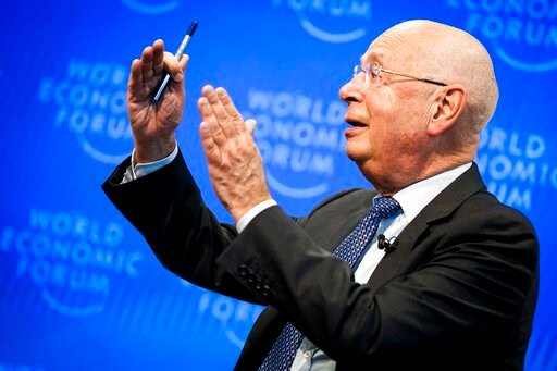 (Valentin Flauraud/Keystone via AP). Klaus Schwab, Founder and Executive Chairman of the World Economic Forum, WEF, gestures during a press conference, in Cologny near Geneva, Switzerland, Tuesday, January 14, 2020. The World Economic Forum unveiled th...