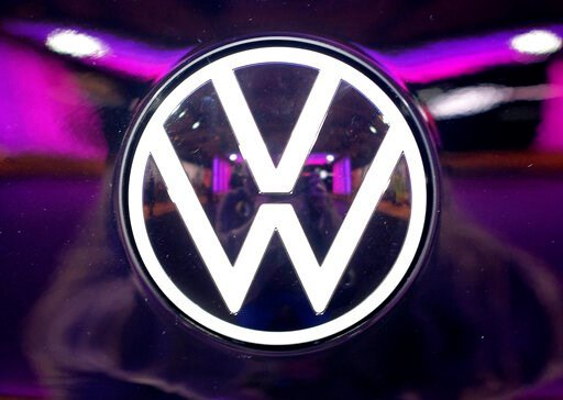 (Sebastian Willnow/dpa via AP). File---Picture taken on Nov.4, 2019 shows the VW logo on a car at a VW factory opening ceremony for electric cars in Zwickau,  Germany.