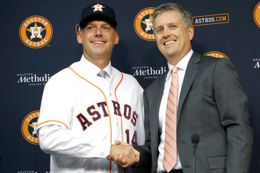 (AP Photo/Pat Sullivan, File). FILE - In this Sept. 29, 2014, file photo, Houston Astros general manager Jeff Luhnow, right, and A.J. Hinch pose after Hinch is introduced as the new manager of the baseball club in Houston. Hinch and Luhnow were fired M...