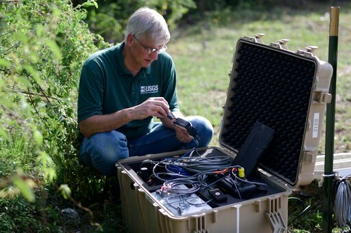 (AP Photo/Carlos Giusti). Thomas L. Pratt, a scientist with the United States Geological Survey, changes data cards in earthquake monitoring and recording equipment amid aftershocks across the island's southern coast where recent quakes have toppled ho...