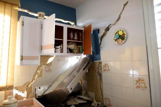 (AP Photo/Carlos Giusti). The house of William Mercuchi is damaged after the previous day's magnitude 6.4 earthquake in Yauco, Puerto Rico, Wednesday, Jan. 8, 2020. More than 250,000 Puerto Ricans remained without water on Wednesday and another half a ...