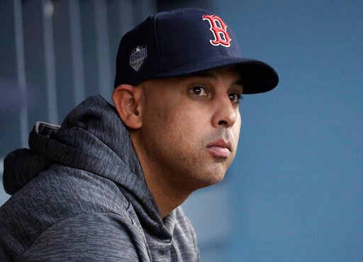 (AP Photo/David J. Phillip, File). FILE - In this Oct. 28, 2018, file photo, Boston Red Sox manager Alex Cora waits for the start of Game 5 of the baseball World Series between the Red Sox and Los Angeles Dodgers in Los Angeles. Cora was fired by the R...