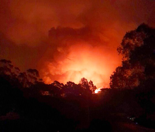 (AP Photo/Siobhan Threlfall). In this Dec. 31, 2019, photo provided by Siobhan Threlfall, a fire approaches the village of Nerrigundah, Australia. The tiny village has been among the hardest hit by Australia's devastating wildfires, with about two thir...
