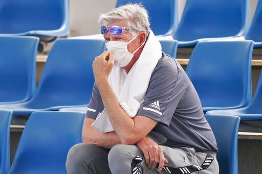 (Michael Dodge/AAP Image via AP). A spectator wears a mask as smoke haze shrouds Melbourne during an Australian Open practice session at Melbourne Park in Australia, Tuesday, Jan. 14, 2020. Smoke haze and poor air quality caused by wildfires temporaril...