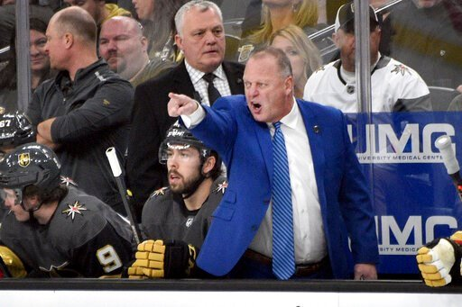 (AP Photo/David Becker). Vegas Golden Knights coach Gerard Gallant questions a call during the first period of the team's NHL hockey game against the Arizona Coyotes on Saturday, Dec. 28, 2019, in Las Vegas.