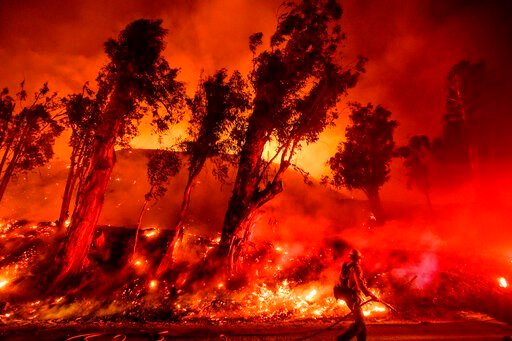 (AP Photo/Noah Berger, File). FILE - In this Nov. 1, 2019, file photo, flames from a backfire consume a hillside as firefighters battle the Maria Fire in Santa Paula, Calif. The decade that just ended was by far the hottest ever measured on Earth, capp...