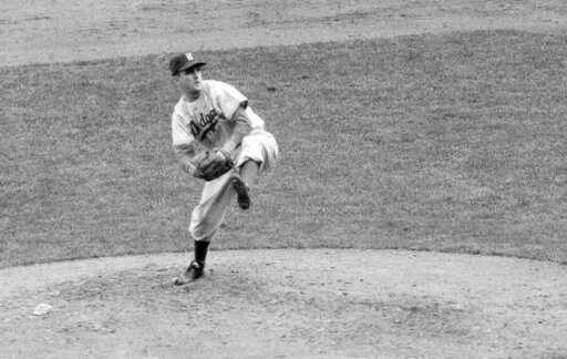 (AP Photo, File). FILE - In this October 1952 file photo, Brooklyn Dodgers' Carl Erskine pitches against the New York Yankees in Game 5 of the baseball World Series in New York. Up by 13 1/2 games in mid-August in 1951, Jackie Robinson and the Dodgers ...