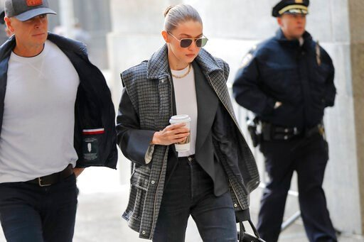 (AP Photo/Seth Wenig). Supermodel Gigi Hadid arrives at a Manhattan courthouse for Harvey Weinstein's jury selection in his trial on rape and sexual assault charges in New York, Thursday, Jan. 16, 2020.