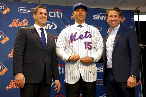 (AP Photo/Seth Wenig, File). FILE - In this Nov. 4, 2019, file photo, new New York Mets manager, Carlos Beltran, center, poses for a picture with general manager Brodie Van Wagenen, left, and Mets COO Jeff Wilpon during a baseball news conference at Ci...