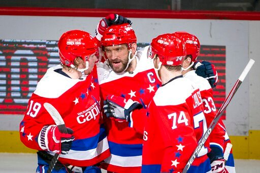 (AP Photo/Al Drago). Washington Capitals left wing Alex Ovechkin (8), from Russia, is congratulated by center Nicklas Backstrom (19) from Sweden, defenseman John Carlson (74), and defenseman Radko Gudas (33), from Czech Republic, after scoring during t...