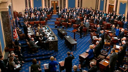 (Senate Television via AP). In this image from video, presiding officer Supreme Court Chief Justice John Roberts swears in members of the Senate for the impeachment trial against President Donald Trump at the U.S. Capitol in Washington, Thursday, Jan. ...