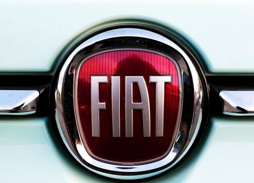 (AP Photo/Bob Edme, File). FILE - In this Oct. 31, 2019 file photo, a Fiat logo is pictured on a car in Bayonne, southwestern France. Fiat Chrysler Automobiles and PSA Peugeot announced Wednesday, Dec. 18, 2019, that their boards signed a binding deal ...