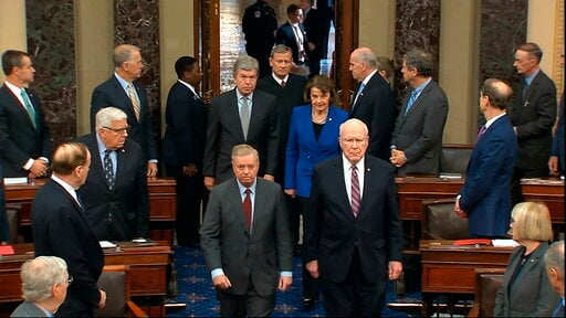 (Senate Television via AP). In this image from video, Sen. Lindsey Graham, R-S.C., left, Sen. Patrick Leahy, D-Vt., Sen. Dianne Feinstein, D-Calif., and Sen. Roy Blunt, R-Mo., escort Supreme Court Chief Justice John Roberts into the Senate chamber in t...