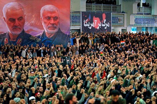 (Office of the Iranian Supreme Leader via AP). In this picture released by the official website of the office of the Iranian supreme leader, worshippers chant slogans during Friday prayers ceremony, as a banner show Iranian Revolutionary Guard Gen. Qas...