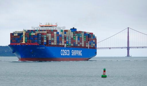 (AP Photo/Eric Risberg, File). FILE - In this May 14, 2019 file photo, a Cosco Shipping container ship passes the Golden Gate Bridge in San Francisco bound for the Port of Oakland. For major shipping companies dealing with trade wars and a slowing glob...
