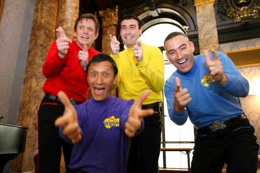 (AP Photo/Christopher Pledger, File). FILE - In this June 28, 2006 file photo, Australian children's entertainers The Wiggles, Murray Cook (Red Wiggle), Greg Page (Yellow Wiggle), Jeff Fatt (Purple Wiggle), and Anthony Field (Blue Wiggle) make a specia...