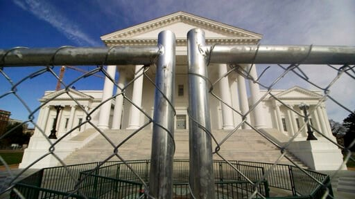 (Dean Hoffmeyer/Richmond Times-Dispatch via AP). The Virginia state Capitol building is surrounded by fencing, Thursday, Jan. 16, 2020 in Richmond, Va., in preparation for Monday's rally by gun rights advocates. Gun-rights groups are asking a judge to ...