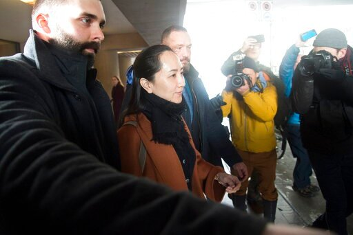 (Jonathan Hayward/The Canadian Press via AP). Huawei chief financial officer Meng Wanzhou, who is out on bail and remains under partial house arrest after she was detained last year at the behest of American authorities, leaves B.C. Supreme Court follo...