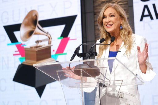 (Photo by Charles Sykes/Invision/AP, File). FILE - In this Wednesday, Nov. 20, 2019, file photo, Recording Academy President/CEO Deborah Dugan participates in the 62nd Grammy Awards nominations news conference at Studio 43 at CBS Broadcast Center in Ne...