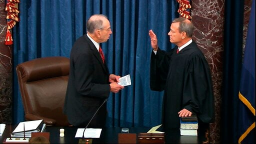 (Senate Television via AP). In this image from video, President Pro Tempore of the Senate Sen. Chuck Grassley, R-Iowa., swears in Supreme Court Chief Justice John Roberts as the presiding officer for the impeachment trial of President Donald Trump in t...