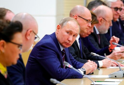 (Mikhail Klimentyev, Sputnik, Kremlin Pool Photo via AP, File). FILE - In this file photo taken on Jan. 16, 2020, Russian President Vladimir Putin attends a meeting on drafting constitutional changes at the Novo-Ogaryovo residence outside Moscow, Russi...