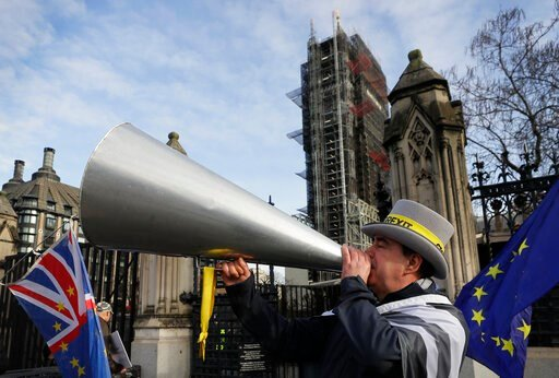 (AP Photo/Kirsty Wigglesworth). Anti Brexit campaigner Steve Bray demonstrates outside Parliament in London, Wednesday, Jan. 15, 2020. Britain is due to leave the European Union on Jan. 31.