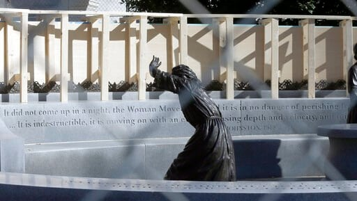 (Bob Brown/Richmond Times-Dispatch via AP). The statue of pioneer woman Laura Ingles is shown behind the fencing put up around the Virginia Women's Memorial on Capitol Square in Richmond, Va.,  Friday, Jan. 17, 2020. The fencing was to protect the monu...