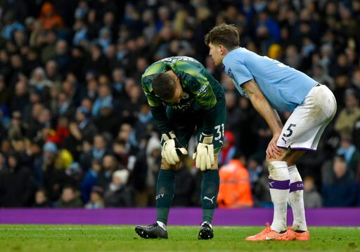 (AP Photo/Rui Vieira). Manchester City's goalkeeper Ederson, left, and Manchester City's John Stones react after Manchester City's Fernandinho scores an own goal during the English Premier League soccer match between Manchester City and Crystal Palace ...