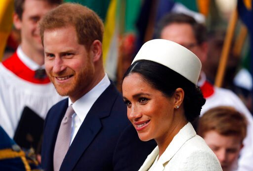 (AP Photo/Frank Augstein, file). FILE - In this Monday, March 11, 2019 file photo, Britain's Prince Harry and Meghan, the Duchess of Sussex leave after the Commonwealth Service at Westminster Abbey in London. Prince Harry and Meghan Markle are to no lo...