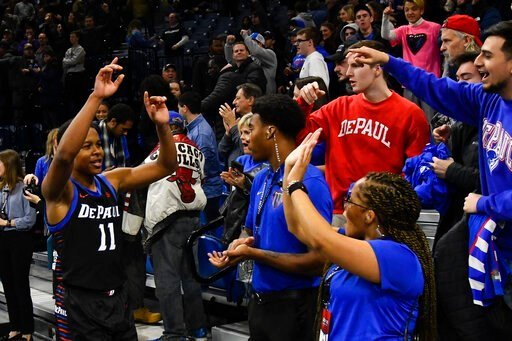 (AP Photo/Matt Marton). DePaul guard Charlie Moore (11) greets fans after an NCAA college basketball game against Butler Saturday, Jan. 18, 2020, in Chicago. DePaul won 79-66.