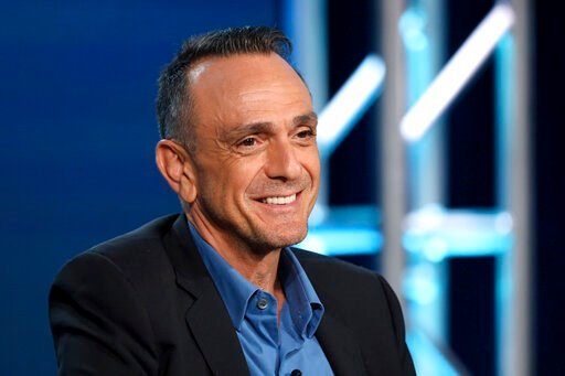 (Photo by Willy Sanjuan/Invision/AP). FILE - In this Jan. 16, 2020 file photo, Hank Azaria speaks during the AMC Networks TCA 2020 Winter Press Tour in Pasadena, Calif. Azaria told the industry blog, slashfilm.com, that he has no plans to continue voic...