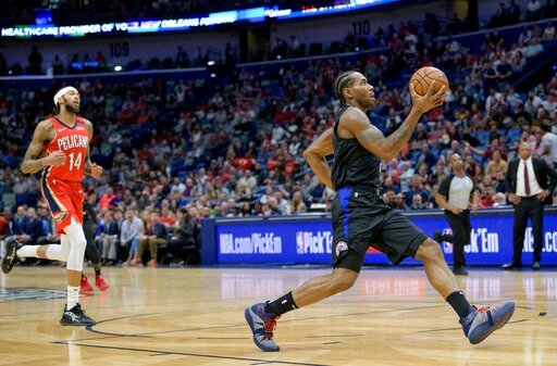 (AP Photo/Matthew Hinton). Los Angeles Clippers forward Kawhi Leonard (2) breaks free for an easy basket against New Orleans Pelicans forward Brandon Ingram (14) in the first half an NBA basketball game in New Orleans, Saturday, Jan. 18, 2020.